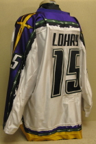 Worn during the 05-06 season by Kevin Lohry. This #15 jersey  was worn by Sioux City native shows lots of wear. Kevin started his hockey career in the Sioux City Youth program and played all through high school. Kevin split his senior year between the Metros and Musketeers.  The following season, 2005-06, he would earn a full time spot on the Musketeer rooster and the next season, 2006-07, he would go on to be named alternate captain and, secure a scholarship at Princeton University.  All-Star Game Patch and NOB . Manufactured by OT Sports, this size 56 shows great wear.