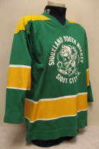 The green jersey with the old little joe logo screened on and Sioux City Iowa on the back were  PeeWee A travel jerseys during the 85-86 season. I believe they were used for a few seasons before that.